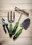 Garden tools on wooden background Royalty Free Stock Photography