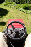 Garden tractor. Red garden tractor moving lawn stock photography