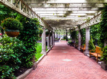 Garden trellis over a path and buildings at Norman B. Leventhal Royalty Free Stock Images