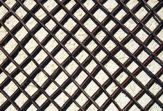 Garden Trellis on Wall. An image suitable for use as a background, wooden garden trellis for climbing plants against a pale wall Royalty Free Stock Photos