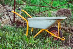 A garden trolley stands in the garden Royalty Free Stock Images