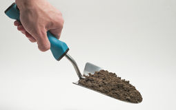 Garden trowel held with dirt Royalty Free Stock Image
