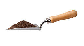 Garden Trowel with Potting Soil Stock Images