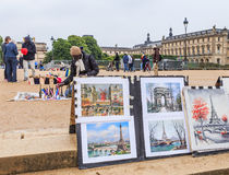 In the garden of the Tuileries, Paris, tourists buy souvenirs Royalty Free Stock Photos