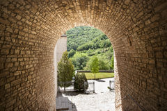 Garden tunnel, light on other side. Stock Photos