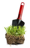 Garden turf and trowel Stock Photos