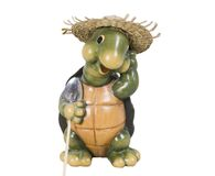 Garden Turtle. A turtle figurine with a straw hat and carring a shovel, ready to do some work in your garden Royalty Free Stock Photography