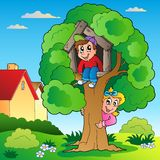 Garden with two kids and tree Royalty Free Stock Image