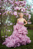 Garden under the magnolia tree is a girl. Royalty Free Stock Image