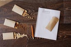 Garden vegetable seeds in handmade envelopes: zuccini or pumpkin stock image