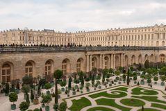 Garden of Versailles. The Palace of Versailles or simply Versailles, is a royal château in Versailles in the Île-de-France region of France. In French it is Stock Photos