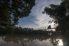 The garden. Very small suspension bridge across the wide river in the jambi Sumatra Indonesia Royalty Free Stock Image