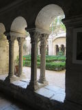 Garden View through Ancient French Columnar Arches Royalty Free Stock Image