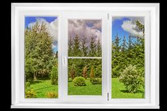 Garden view from a country house window in a sunny summer day isolated on the black royalty free stock photos