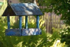 Garden village sunlight plant trees bird feeders. Garden village green plants sunlight summer bird feeders trees stock photos