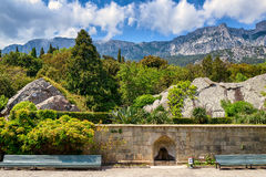 The garden at the Vorontsov Palace in Crimea. ALUPKA, CRIMEA - MAY 20, 2016: The garden at the Vorontsov Palace. Mountain Ai-Petri in the distance. This palace stock images
