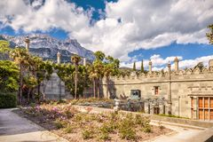 Garden at the Vorontsov Palace overlooking mount Ai-Petri, Crime. Crimea - May 20, 2016: Garden at Vorontsov Palace overlooking mount Ai-Petri in Crimea, Russia stock image