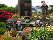 Garden Wagon. Colorful artsy wagon in garden with wooden tower Stock Photos