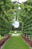 Garden walkway with pergola Stock Photos