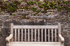 Garden Wall and Bench at Muckross House. Even the walls sprout green and blossoms on the Emerald Isle Royalty Free Stock Photography