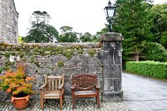 Garden Wall and Benches at Muckross House, Killarney, Ireland. Muckross House, County Kerry, Ireland - is a Tudor style mansion built in 1843 located on the Royalty Free Stock Photos