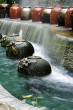 Garden water falls. Garden water geysers in the park Royalty Free Stock Photo