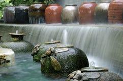 Garden water falls. Garden water geysers in the park Stock Photo