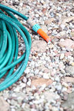 Garden water hose outdoor sand Royalty Free Stock Photography