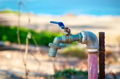 Garden water tap outside. Royalty Free Stock Photo