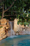 Garden waterfall with pond Royalty Free Stock Image
