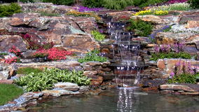 Garden waterfall on the rock Royalty Free Stock Images