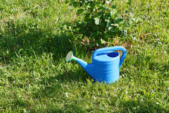Garden watering can on grass Stock Photography