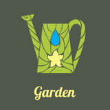 Garden watering can with straw and flower Stock Photos
