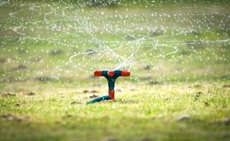 Garden watering system with spiral sprays. Stock Photo