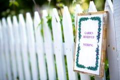 Garden wedding. A sign reserves a garden for a wedding Royalty Free Stock Photography
