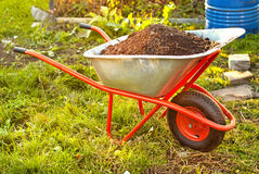 Garden wheelbarrow Stock Images