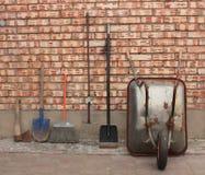 Garden wheelbarrow and garden tools Royalty Free Stock Images