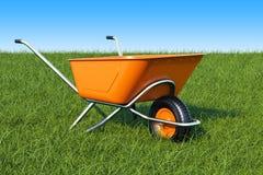 Garden wheelbarrow on the green grass against blue sky, 3d rende. Garden wheelbarrow on the green grass against blue sky, 3d Stock Photo