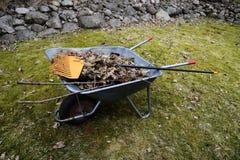 Garden wheelbarrow with leaves Royalty Free Stock Photography