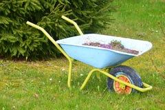 Garden Wheelbarrow. Old blue garden wheelbarrow for carry the heavy things, helps to make work in a garden Stock Images