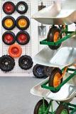 Garden wheelbarrows with spare wheels in shop Stock Photo