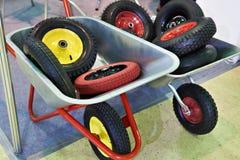 Garden wheelbarrows with spare wheels in shop Royalty Free Stock Photography