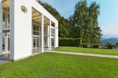 Garden of a white modern villa Stock Photos