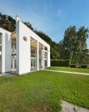 Garden of a white modern villa Stock Photo