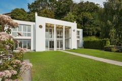 Garden of a white modern villa Stock Image