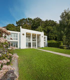 Garden of a white modern villa Stock Images