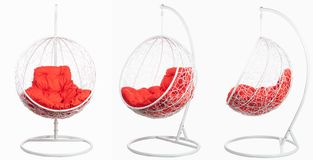 Garden wicker furniture. Hanging swing with stand and soft pillow. Set of three angles on a white background. Garden wicker furniture. Hanging swing with stand royalty free stock image