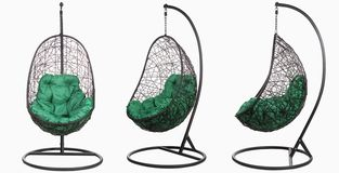 Garden wicker furniture. Hanging swing with stand and soft pillow. Set of three angles on a white background. Garden wicker furniture. Hanging swing with stand royalty free stock photos