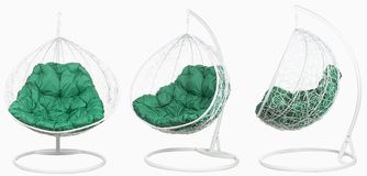 Garden wicker furniture. Hanging swing with stand and soft pillow. Set of three angles on a white background. Garden wicker furniture. Hanging swing with stand stock photo