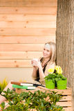 Garden woman terrace enjoy rest cup coffee Stock Images